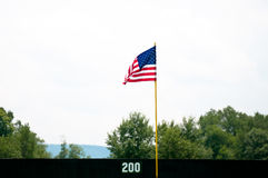 American flag pole in outfield Stock Photos