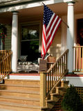 American flag on porch. Royalty Free Stock Image