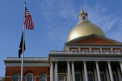 American Flag with POW MIA in front of State House Stock Image