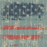 The American flag print against a wooden wall. Royalty Free Stock Images