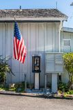 American flag and public phone. The american flag upon a public phone and some mailboxes California Royalty Free Stock Image