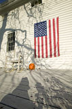 American flag, pumpkin and rocking chair on porch of home in Newport, Rhode Island Royalty Free Stock Photo