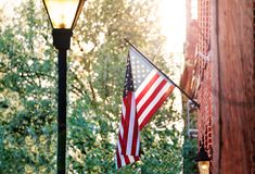 American flag on the red brick house in Baltimore stock image