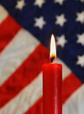 American flag and red candle Royalty Free Stock Photography