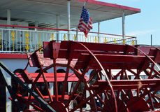 American Flag and Red Paddle Wheel Boat. Closeup and detail of a red paddle wheel boat with an American Flag Royalty Free Stock Image