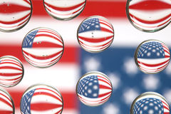 American flag reflected in water drops Royalty Free Stock Photos