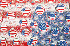American flag reflected in water drops Royalty Free Stock Images