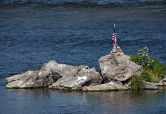 American flag on a rock island Royalty Free Stock Images
