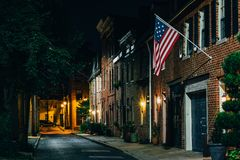 American flag and row houses on Bethel Street at night, in Fells Point, Baltimore, Maryland.  royalty free stock photos