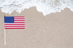 American flag on the sandy beach Royalty Free Stock Photo