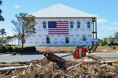 American flag on the side of a Hurricane Damaged Home stock photo