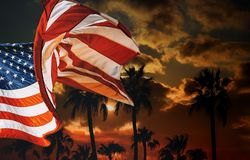 American flag at silhouette palm trees on sunset. Golfers paradise, independence, day, palms, patriotism, usa, sky, summer, travel, tropical, nature, landscape stock photos
