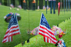 American Flag sits next to Vietnam memorial with reflection. Flag and its reflection on a traveling Vietnam memorial wall monument Stock Photos