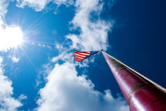 American Flag and sky Stock Images