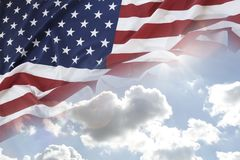 American flag in sky. American flag in blue sky Royalty Free Stock Photography