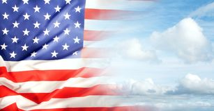 American flag in sky. American flag in blue sky Royalty Free Stock Photo