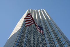 American flag and a skyscraper Stock Photos