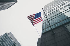 American flag and skyscrapers Stock Photo