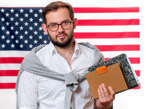 American flag. Smiling young man on United States flag background. Stock Images