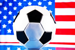 American flag and soccer ball. American flag in the background and soccer ball Royalty Free Stock Photo