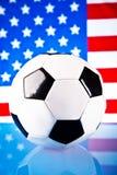 American flag and soccer ball Stock Photos