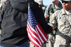 American Flag and Soldiers deploying. Soldiers preparing to deploy November 28 2012 Fort Bragg NC Fort Bragg NC stock image