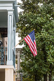 American Flag on Southern Home with Magnolia Tree Stock Photos