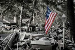 Hurricane Harvey Aftermath. American flag standing outside Houston area home devastated after Hurricane Harvey royalty free stock photo