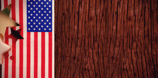 American flag and star shape decoration arranged on wooden table Royalty Free Stock Images