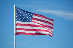 American flag Stars and Stripes blowing in the wind Royalty Free Stock Photo