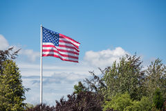 American flag Stars and Stripes blowing in the wind Royalty Free Stock Image