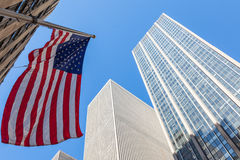 American flag stars and stripes floating in front of Manhattan s Stock Image
