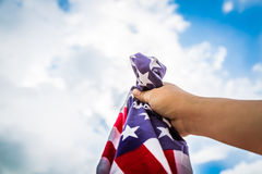 American flag with stars and stripes hold Stock Photography