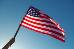American flag with stars and stripes hold Royalty Free Stock Photo