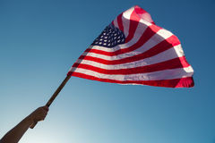 American flag with stars and stripes hold Stock Image