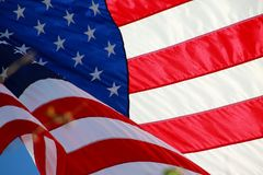 American Flag. The stars and stripes of the American flag wave and flutter patriotically in the afternoon sun Royalty Free Stock Photography
