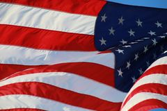 American Flag. The stars and stripes of the American flag wave and flutter patriotically in the afternoon sun Stock Photos
