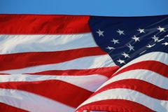 American Flag. The stars and stripes of the American flag wave and flutter patriotically in the afternoon sun Royalty Free Stock Images