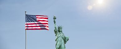 American flag with statue stock photo
