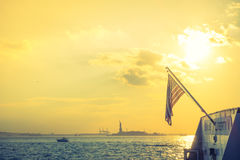 American flag with Statue of Liberty, New York City , USA .  ( F Stock Photos