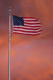 American Flag in Storm Clouds. American Flag waving in storm clouds. Taken at the Washington Monument moments before a rainstorm Royalty Free Stock Photography