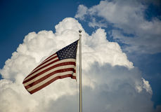 American Flag & Storm Clouds Stock Image