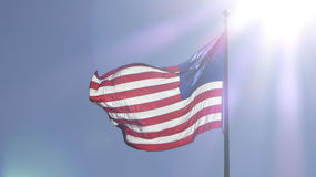 American Flag with Sun Rays Backlighting Stock Photography