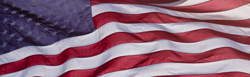 American Flag. With sun shining through on windy day Stock Photo