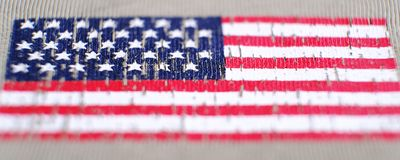 American flag on a t-shirt of a us army soldier. Selective focus stock photos