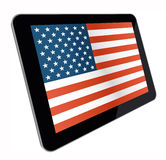 American Flag on tablet computer. Tablet device with American flag on plain background on screen as seen in perspective. All files isolated on a white background Royalty Free Stock Image