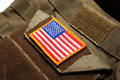 American flag on tactical vest. American flag on a green tactical vest. Shallow DOF Royalty Free Stock Photography