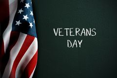 Text veterans day and american flag royalty free stock photos
