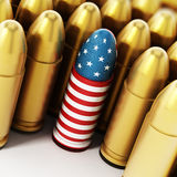 American flag textured bullet among yellow bullets. 3D illustration.  Stock Photo