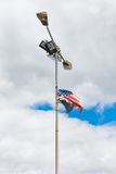 American flag tied to an old lamp post Royalty Free Stock Photo